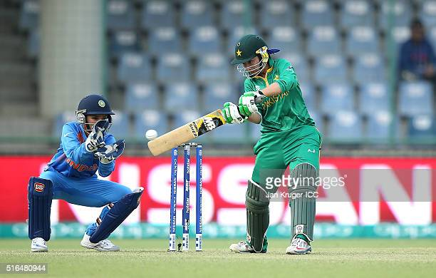 Nahida Khan of Pakistan plays a cut shot with Sushma Verma of India looking on during the Women's ICC World Twenty20 India 2016 match between India...