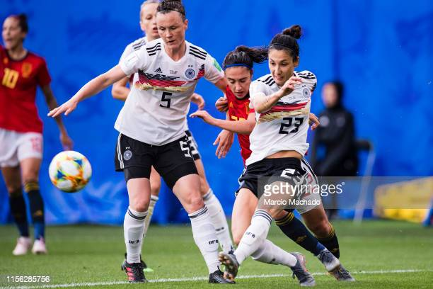 Nahikari Garcia of Spain fights for the ball with Sara Doorsoun of Germany during the 2019 FIFA Women's World Cup France group B match between...