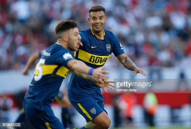 Nahitan Nandez and Edwin Cardona of Boca Juniors celebrate after the first goal of his team during a match between River Plate and Boca Juniors as...