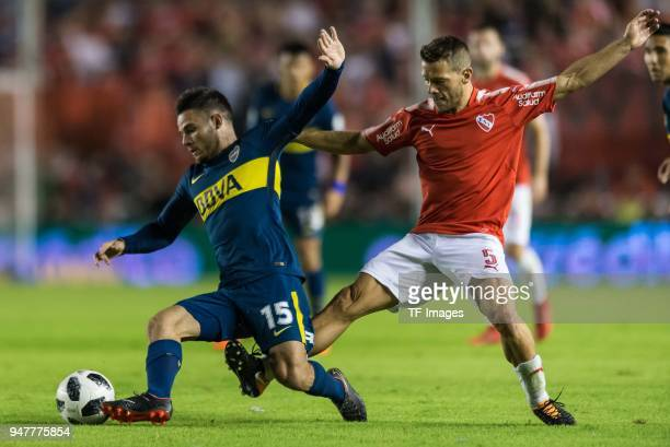 Nahitan Nandez of Boca Juniors and Nicolas Domingo of Independiente battle for the ball during a match between Independiente and Boca Juniors as part...