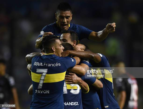 Nahitan Nandez of Boca Juniors celebrates with teammates after scoring the second goal of his team during a match between Boca Juniors and Colon as...