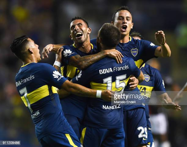 Nahitan Nandez of Boca Juniors celebrates with teammates Leonardo Jara Carlos Tevez and Cristian Pavon after scoring the second goal of his team...
