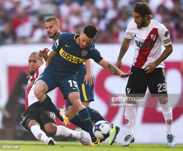 Nahitan Nandez of Boca Juniors fights for ball with Jonathan Maidana of River Plate during a match between River Plate and Boca Juniors as part of...