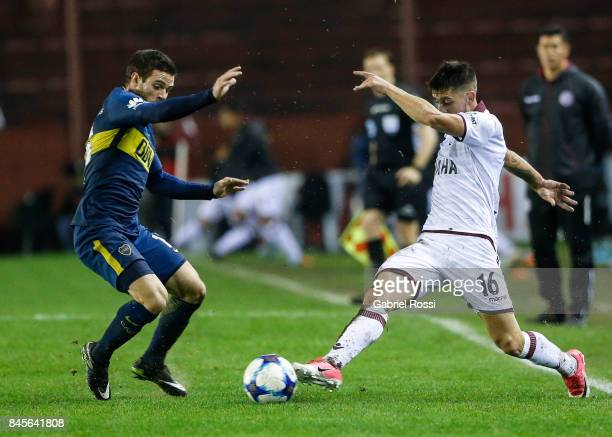 Nahitan Nandez of Boca Juniors fights for the ball with Alejandro Silva of Lanus during a match between Lanus and Boca Juniors as part of the...