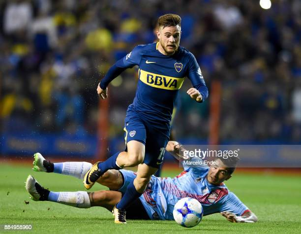 Nahitan Nandez of Boca Juniors fights for the ball with David Drocco of Arsenal during a match between Boca Juniors and Arsenal as part of the...