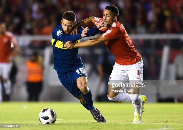 Nahitan Nandez of Boca Juniors fights for the ball with Nicolas Figal of Independiente during a match between Independiente and Boca Juniors as part...
