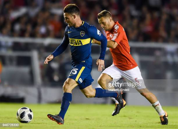 Nahitan Nandez of Boca Juniors fights for the ball with Nicolas Domingo of Independiente during a match between Independiente and Boca Juniors as...