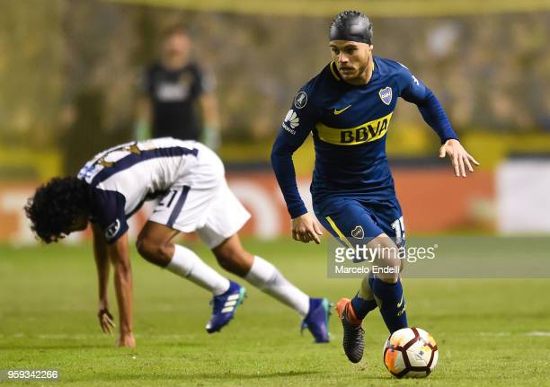Nahitan Nandez of Boca Juniors fights for the ball with Oscar Vilchez of Alianza Lima during a match between Boca Juniors and Alianza Lima at Alberto...