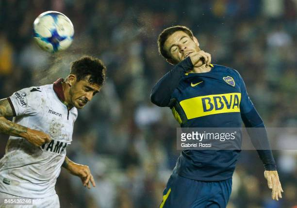 Nahitan Nandez of Boca Juniors fights for the ball with Roman Martinez of Lanus during a match between Lanus and Boca Juniors as part of the...