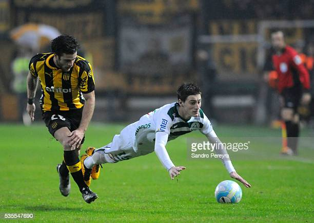 Nahitan Nandez of Penarol and Facundo Waller of Plaza Colonia fight for the ball during a match between Penarol and Plaza Colonia as part of...