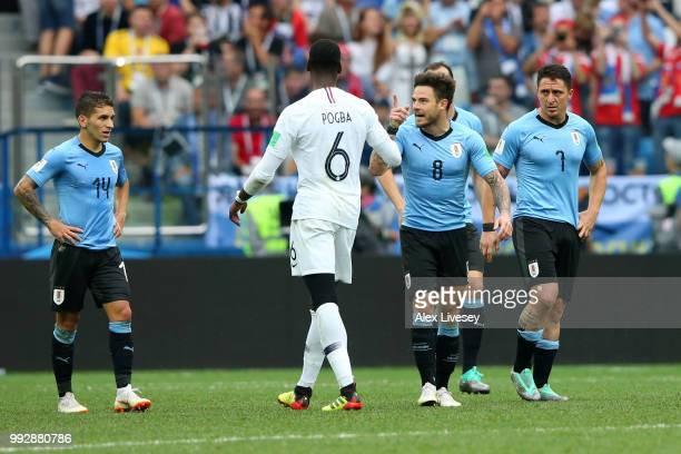 Nahitan Nandez of Uruguay and Paul Pogba of France have words during the 2018 FIFA World Cup Russia Quarter Final match between Uruguay and France at...
