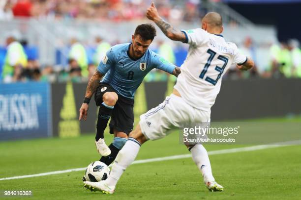 Nahitan Nandez of Uruguay battles for the ball with Fedor Kudryashov of Russia during the 2018 FIFA World Cup Russia group A match between Uruguay...