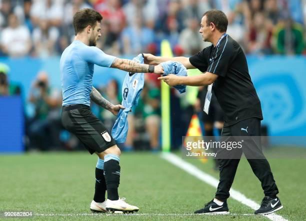 Nahitan Nandez of Uruguay changes shirt during the 2018 FIFA World Cup Russia Quarter Final match between Uruguay and France at Nizhny Novgorod...