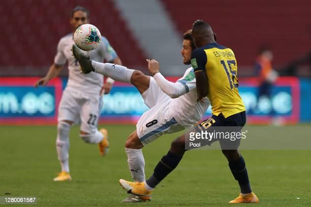 Nahitan Nandez of Uruguay fights for the ball with Pervis Estupiñan of Ecuador during a match between Ecuador and Uruguay as part of South American...