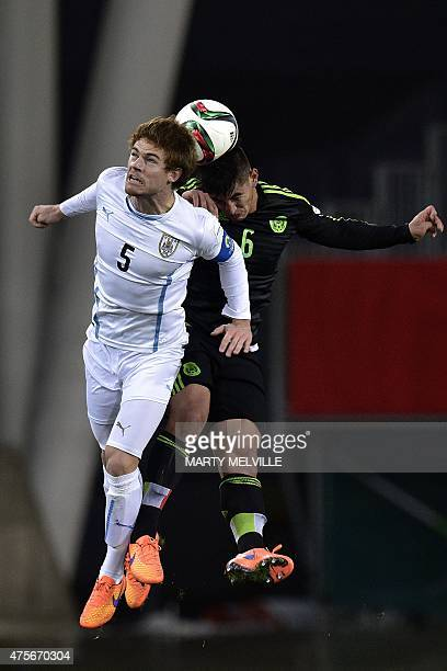 Nahitan Nandez of Uruguay jumps for the ball with Victor Guzman of Mexico during the FIFA Under20 World Cup football match between Mexico and Uruguay...