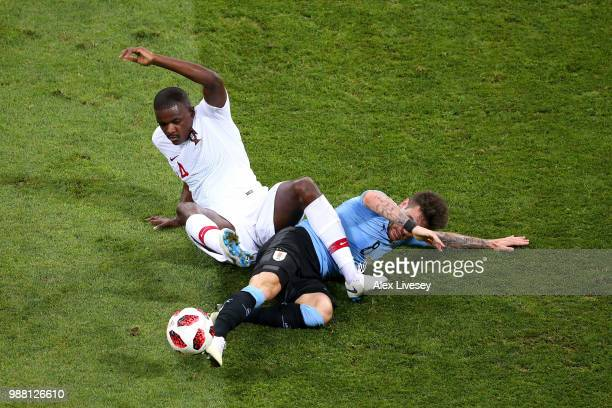Nahitan Nandez of Uruguay tackles William of Portugal during the 2018 FIFA World Cup Russia Round of 16 match between Uruguay and Portugal at Fisht...