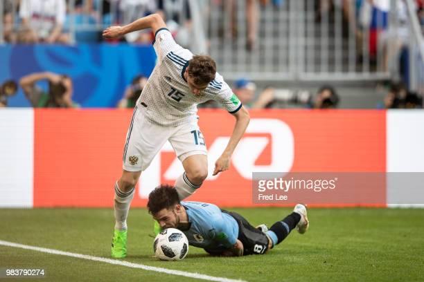 Nahitan Nandez of Uruguay vies Alexey Miranchuk of Russia during the 2018 FIFA World Cup Russia group A match between Uruguay and Russia at Samara...