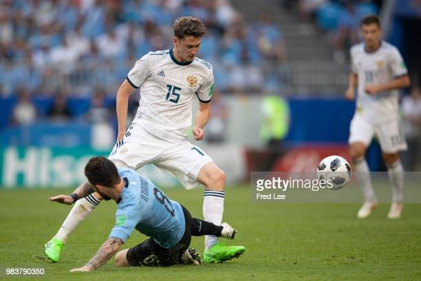 Nahitan Nandez of Uruguay vies Alexey Miranchuk of Russia during the 2018 FIFA World Cup Russia group A match between Uruguay and Russia at Samara...