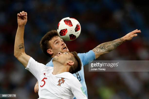 Nahitan Nandez of Uruguay wins a header over Raphael Guerreiro of Portugal during the 2018 FIFA World Cup Russia Round of 16 match between Uruguay...