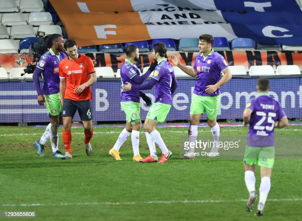 Nahki Wells and Chris Martin of Bristol City celebrate the own goal scored by Sonny Bradley of Luton Town during the Sky Bet Championship match...