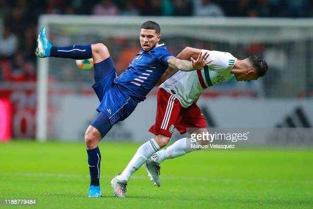 Nahki Wells of Bermuda struggles for the ball against Hector Moreno of Mexico during the match between Mexico and Bermuda as part of the Concacaf...