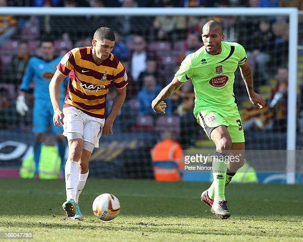 Nahki Wells of Bradford City controls the ball watched by Clarke Carlisle of Northampton Town during the npower League Two match between Bradford...