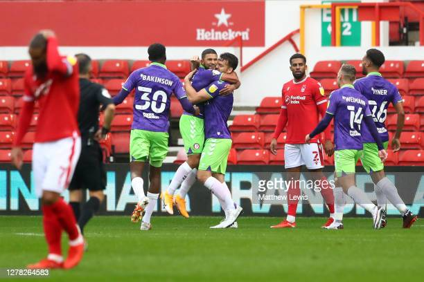 Nahki Wells of Bristol City celebrates with teammates after scoring his sides second goal during the Sky Bet Championship match between Nottingham...