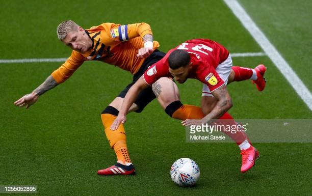 Nahki Wells of Bristol City challenges Jordy de Wijs of Hull City during the Sky Bet Championship match between Bristol City and Hull City at Ashton...