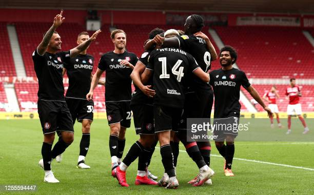 Nahki Wells of Bristol City is congratulated after scoring his second goal and his teams third goal during the Sky Bet Championship match between...
