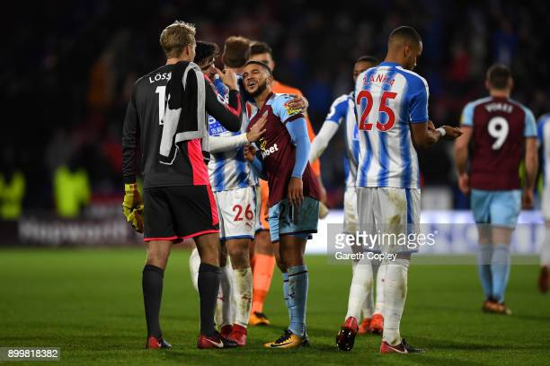 Nahki Wells of Burnley hug his former team mates during the Premier League match between Huddersfield Town and Burnley at John Smith's Stadium on...