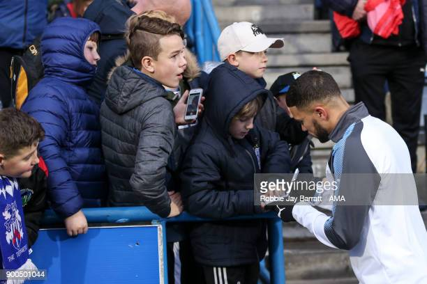 Nahki Wells of Burnley signs autographs for your Huddersfield Town fans during the Premier League match between Huddersfield Town and Burnley at John...