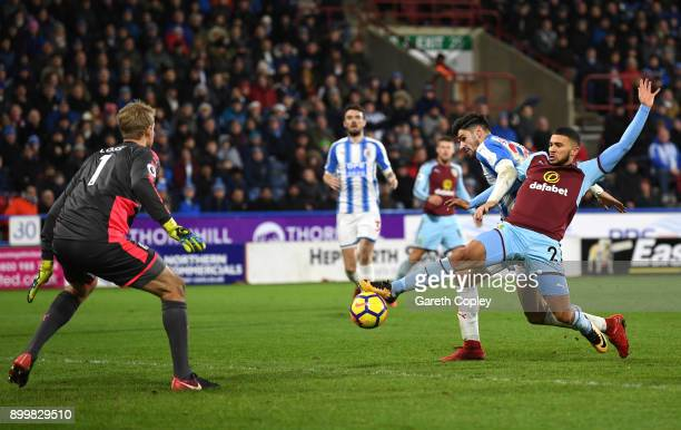 Nahki Wells of Burnley stretches to control the ball under pressure from Christopher Schindler of Huddersfield Town during the Premier League match...