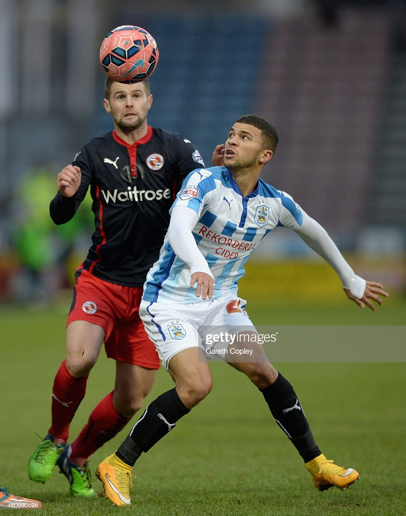Nahki Wells of Huddersfield and Oliver Norwood of Reading battle for the ball during the FA Cup Third Round match between Huddersfield Town and Reading at Galpharm Stadium on January 3, 2015 in Huddersfield, England.