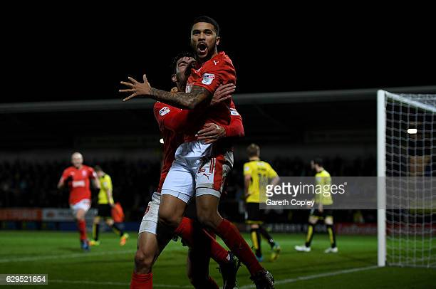 Nahki Wells of Huddersfield celebrates scoring the opening goal during the Sky Bet Championship match between Burton Albion and Huddersfield Town at...
