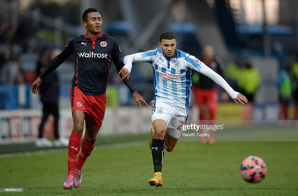 Nahki Wells of Huddersfield gets past Jordan Obita of Reading during the FA Cup Third Round match between Huddersfield Town and Reading at Galpharm Stadium on January 3, 2015 in Huddersfield, England.