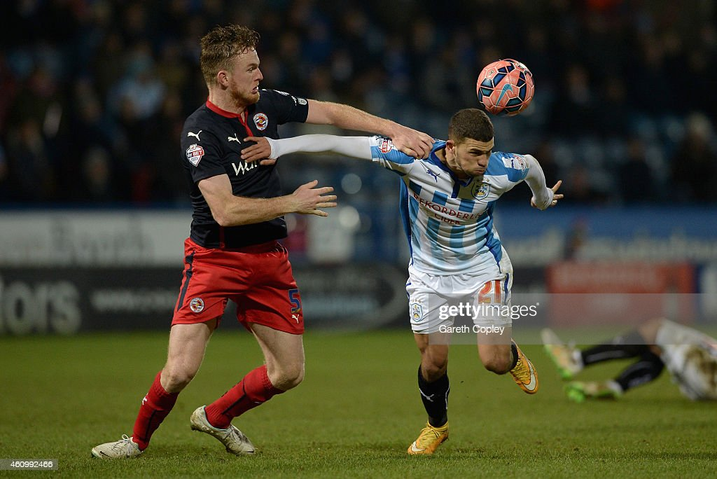 Nahki Wells of Huddersfield is tackled by Alex Pearce of Reading during the FA Cup Third Round match between Huddersfield Town and Reading at Galpharm Stadium on January 3, 2015 in Huddersfield, England.