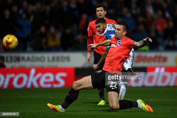 Nahki Wells of Huddersfield scores his team's second goal past Shane Duffy of Brighton during the Sky Bet Championship match between Huddersfield...