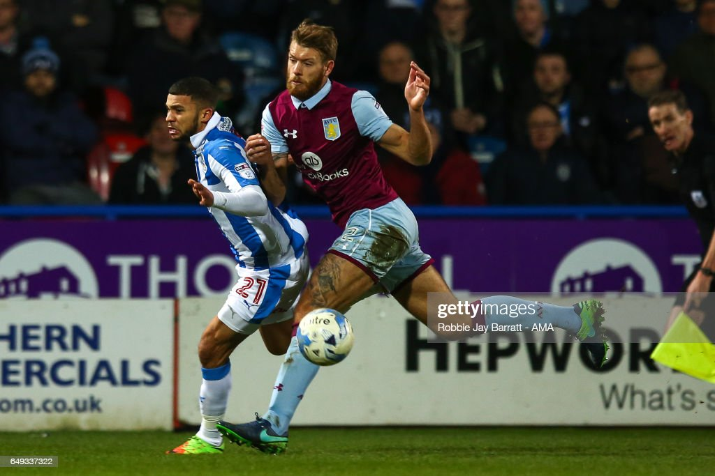 Nahki Wells of Huddersfield Town and James Bree of Aston Villa during the Sky Bet Championship match between Huddersfield Town and Aston Villa at John Smith's Stadium on March 7, 2017 in Huddersfield, England.