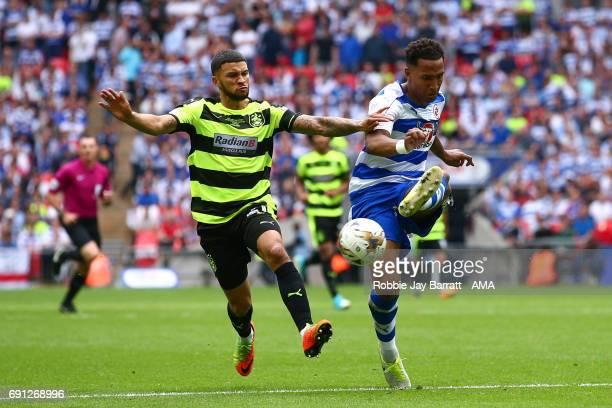 Nahki Wells of Huddersfield Town and Jordan Obita of Reading during the Sky Bet Championship Play Off Final match between Reading and Huddersfield...