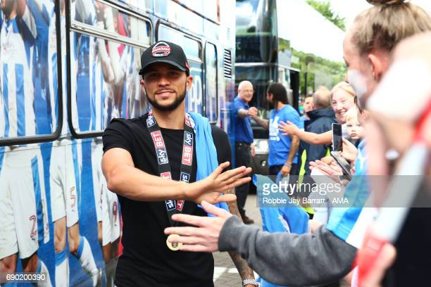 Nahki Wells of Huddersfield Town arrives for the open top bus parade on May 30 2017 in Huddersfield England
