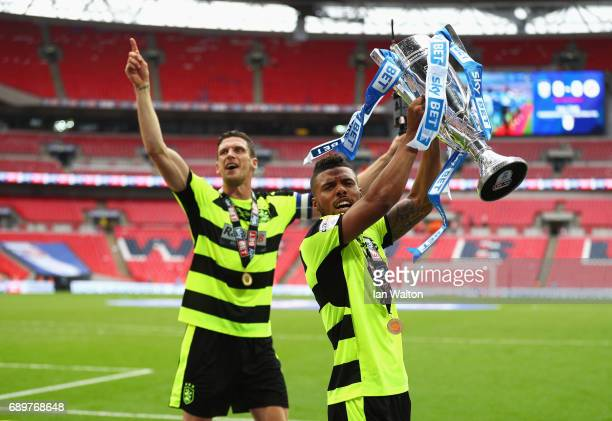 Nahki Wells of Huddersfield Town celebrates with The Championship play off trophy after the Sky Bet Championship play off final between Huddersfield...