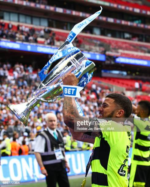 Nahki Wells of Huddersfield Town celebrates with the play off final trophy during the Sky Bet Championship Play Off Final match between Reading and...