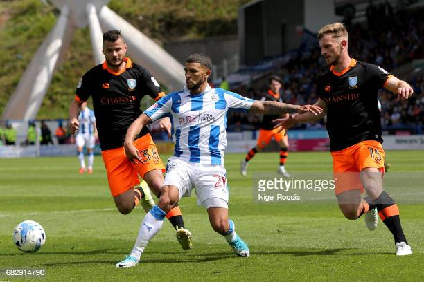 Nahki Wells of Huddersfield Town is put under pressure from Tom Lees of Sheffield Wednesday during the Sky Bet Championship Play Off Semi Final 1st...