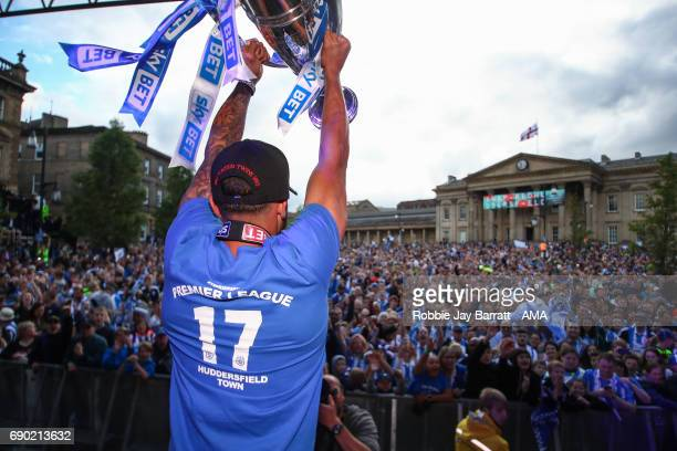 Nahki Wells of Huddersfield Town lifts the Sky Bet Championship play offs trophy on May 30 2017 in Huddersfield England Nahki Wells