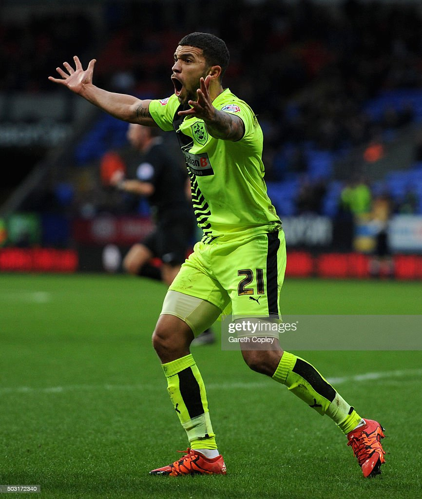 Nahki Wells of Huddersfield Town reacts after making first half claim for a penalty during the Sky Bet Championship match between Bolton Wanderers and Huddersfield Town at the Macron Stadium on January 2, 2016 in Bolton, United Kingdom.