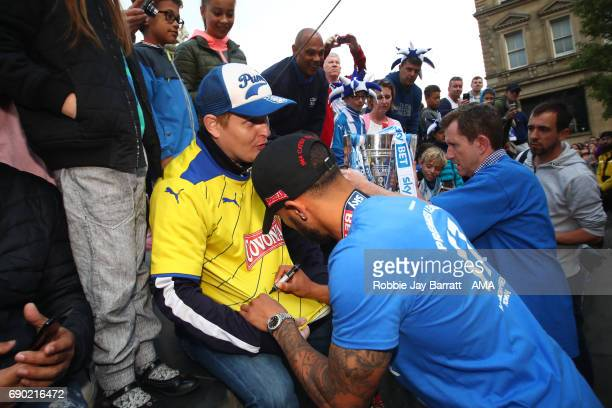 Nahki Wells of Huddersfield Town signs autographs for fans on May 30 2017 in Huddersfield England