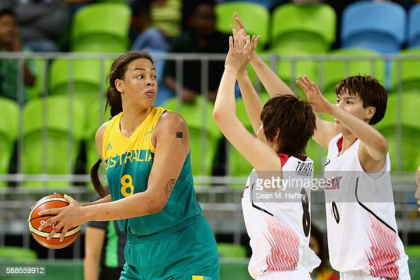Naho Miyoshi and Ramu Tokashiki of Japan defend Elizabeth Cambage of Australia during a Women's Preliminary Group B match on Day 6 of the Rio 2016...