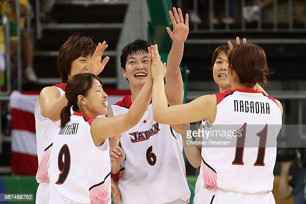Naho Miyoshi, Yuka Mamiya and Moeko Nagaoka of Japan celebrate after defeating Brazil in the women's basketball game on Day 3 of the Rio 2016 Olympic...