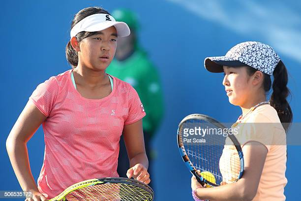 Naho Sato and Stako Sueno of Japan compete in their match against Alexandra Bozovic and Kaylah McPhee of Australia during the Australian Open 2016...