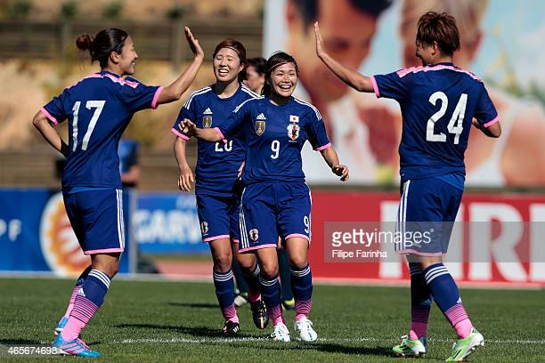 Nahomi Kawasumi and her teammates of Japan celebrate the first goal during the Women's Algarve Cup match between Japan and France on March 9 2015 in...